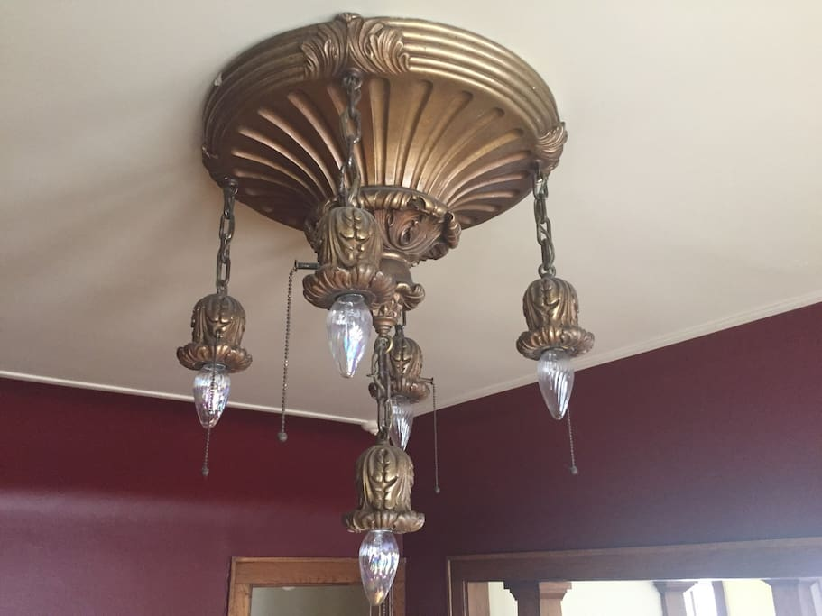Vintage dining room chandelier.  I actually carry this back on my lap back from Toronto in the 1980s.