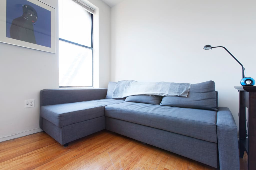 This couch pulls out into a bed for one or two