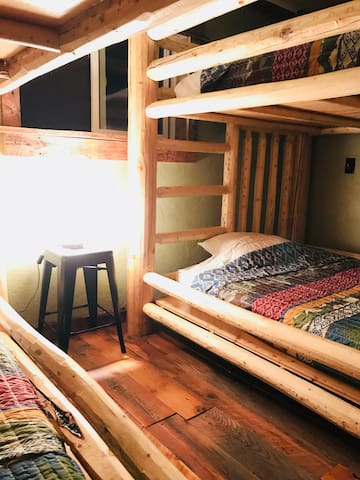 Yes, those are FULL SIZE bunk bed sets! This bedroom is a communal space so make a plan to like each other enough to sleep 4+ people in here!