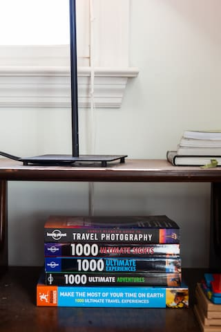 Bunch of travel books to inspire wanderlust.