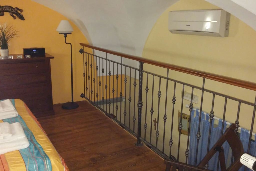 Wooden loft with double bed