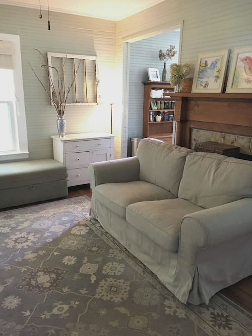 Cozy living area with two loveseat couches and room for the full size air mattress.