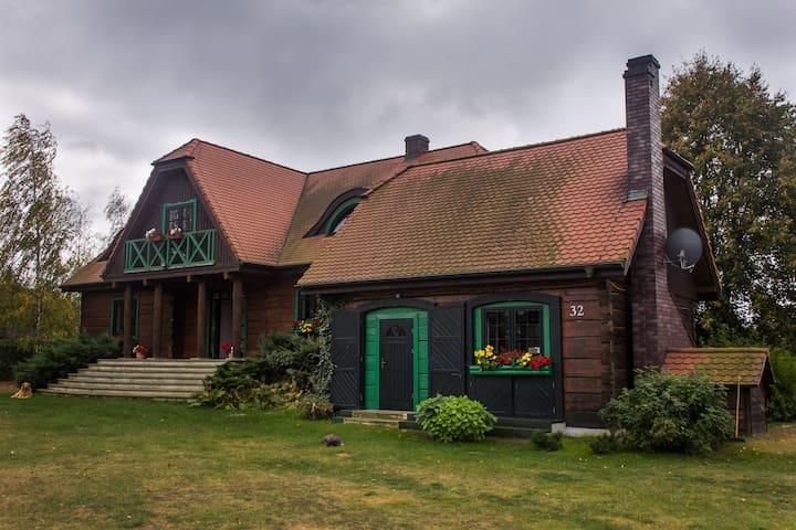 Drewniany dom jezioro Mazury - Łąkorz - Huis