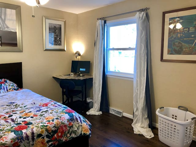 Bedroom has a King size bed and a desk