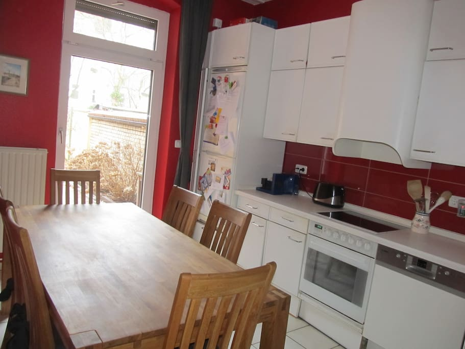 Fully-equipped kitchen with direct access to your own garden and terrace
