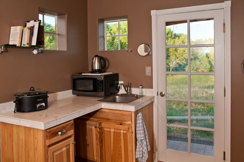 Minimalist!     Mini fridge, microwave, boil pot, crock pot, sink runs when irrigation pump is on (not always)