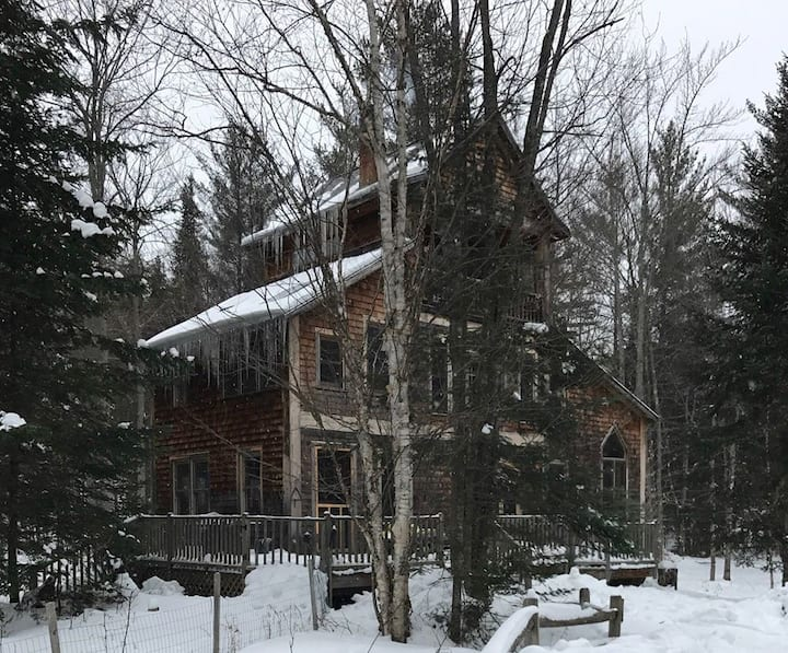 private hand made house in the woods.