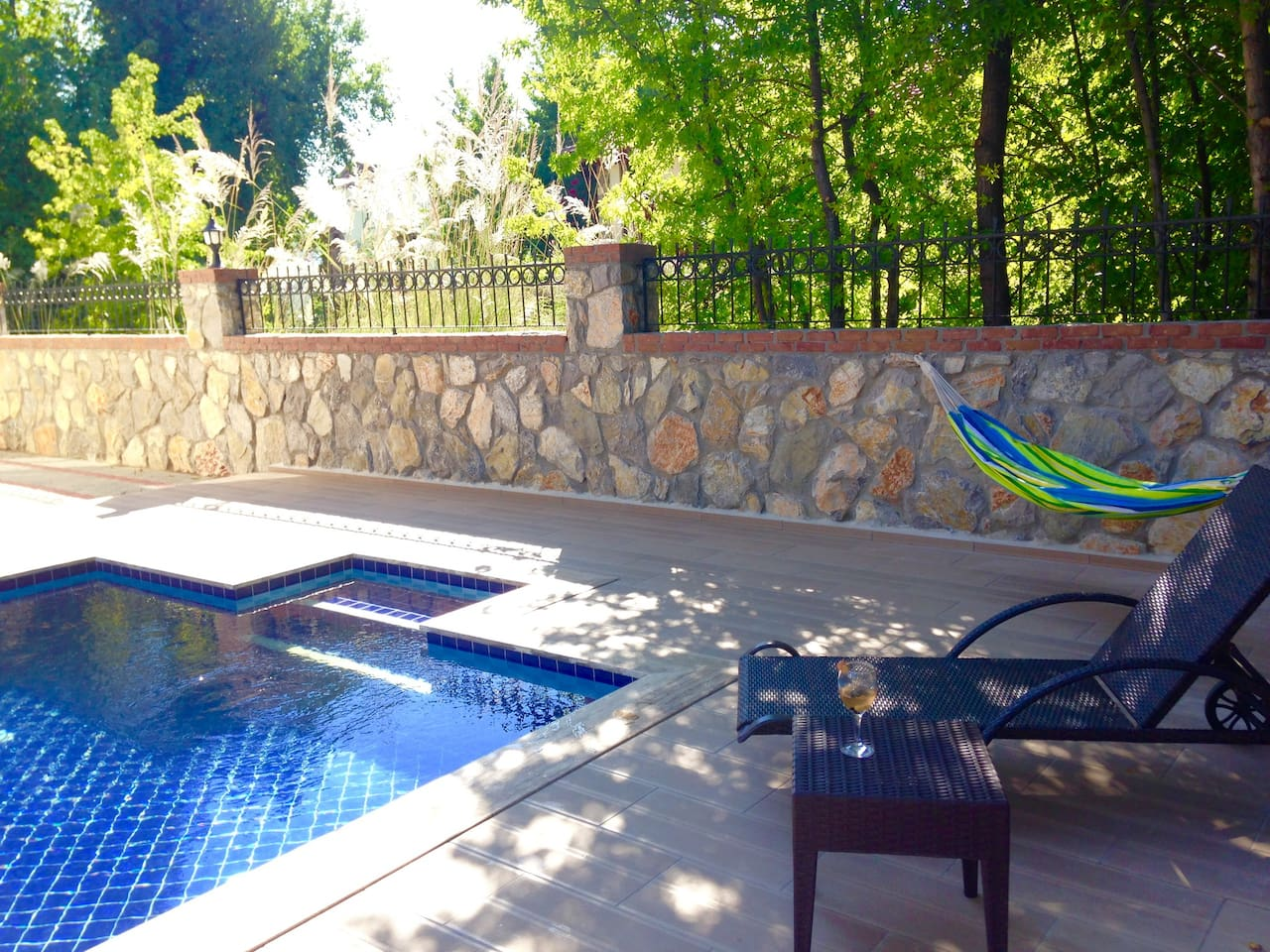 Relax and enjoy your stay by the pool shared only by 4 apartments.