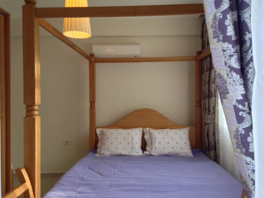 Comfortable and well design bedroom with huge bed, wardrobe and make up table. View for the pool.