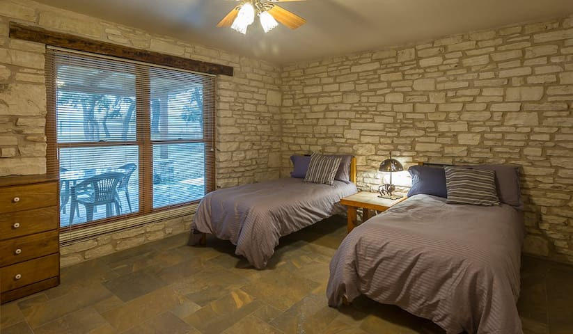 """Two twin beds in the third bedroom. Can be converted to a """"King"""" upon request."""