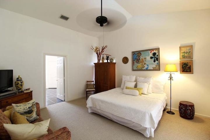 Elegant Master Bedroom with Private Patio and Pool
