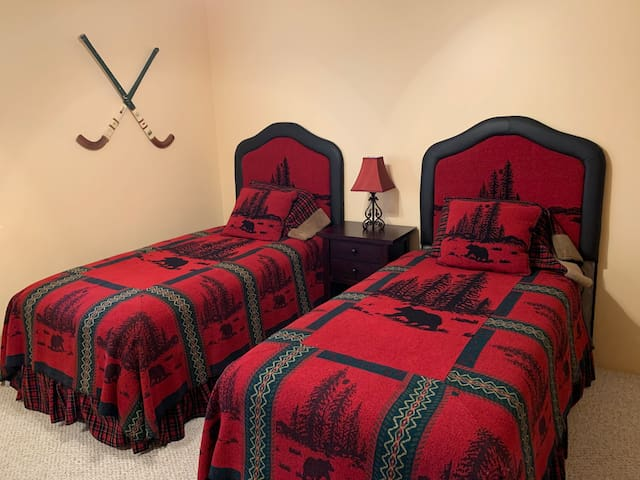 Two twin beds in bedroom.