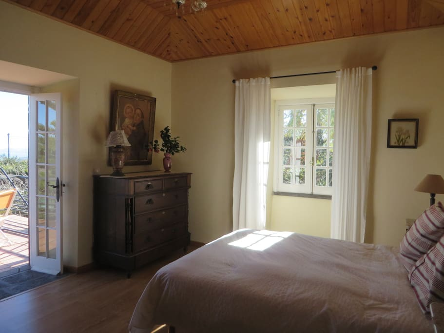 Master Bedroom: Queen size mattress, carefully restored antique dresser, armoire and side tables