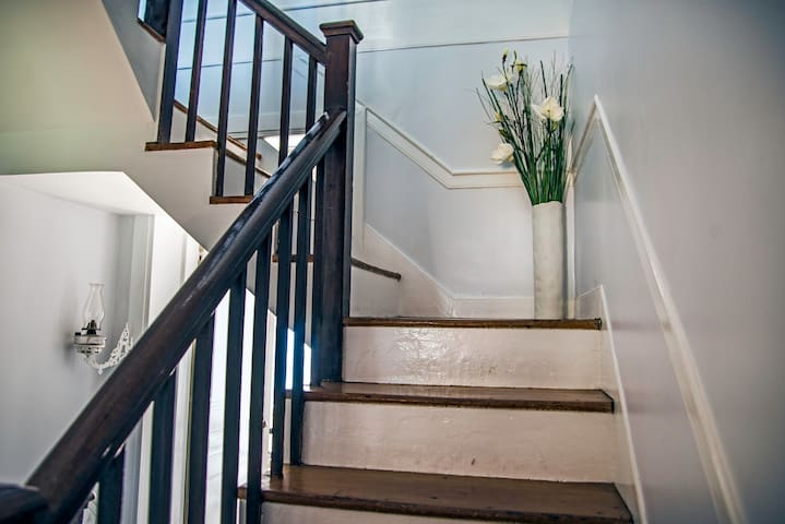 stairs to 3rd floor dormer room called the Lookout room so called for the hidden door that leads to