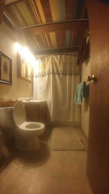 Shared bathroom with tub/ high pressure shower.