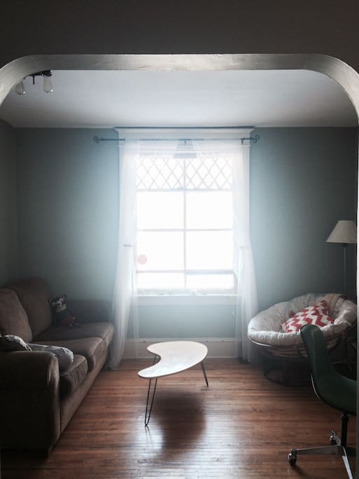 The living room gets the most sunshine in the afternoon. The window looks out over Nutana School Park, dog friendly and great for picnics in the summer. (Note: Some furniture has been rearranged since this photo was taken.)