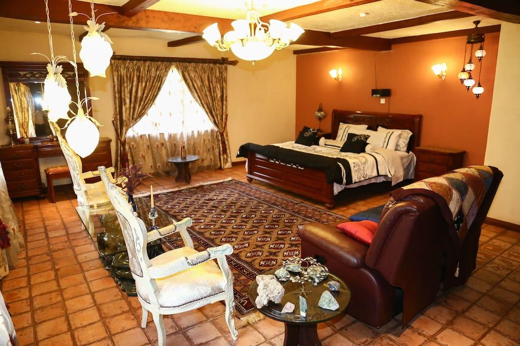 A tastefully furnished master bedroom fit for royalty