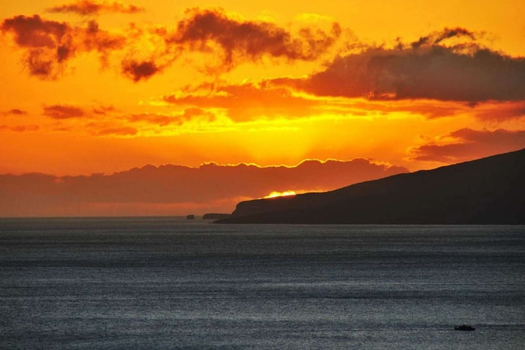 Beautiful Maui Sunset with views of Molokai in the background.