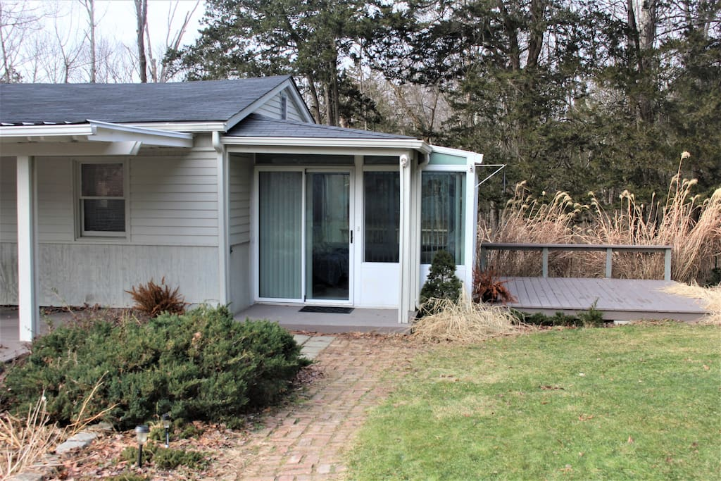 Nice one bedroom cottage with great sunroom and lots of outdoor space