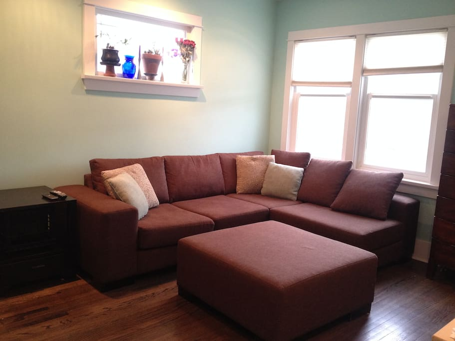Comfortable modern sectional sofa, great for cozy movie nights on the smart LCD TV or as an extra sleeping space.