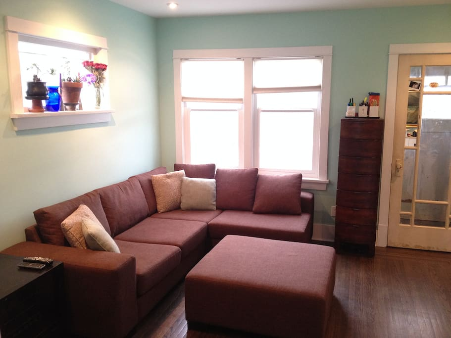 Bright living area, open to kitchen for a modern and spacious feel.
