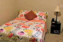 A bed bench has been added for your convenience, and you may see this bright and colorful quilt on your bed.