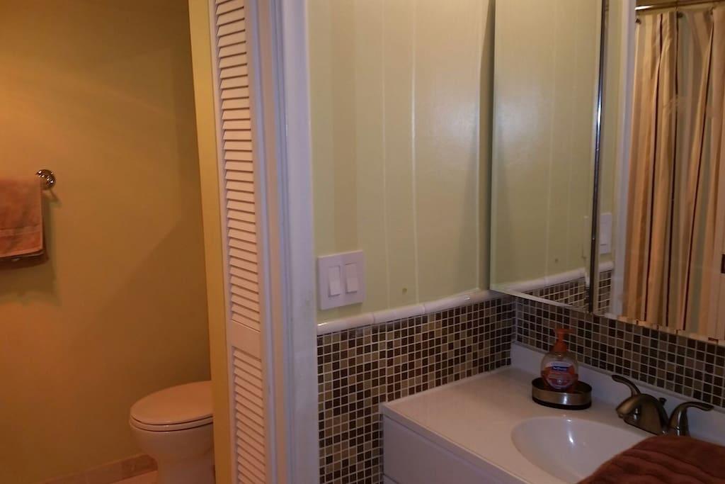 Upstairs bathroom.  Modestly updated, new toilet, vanity, mirror, etc...