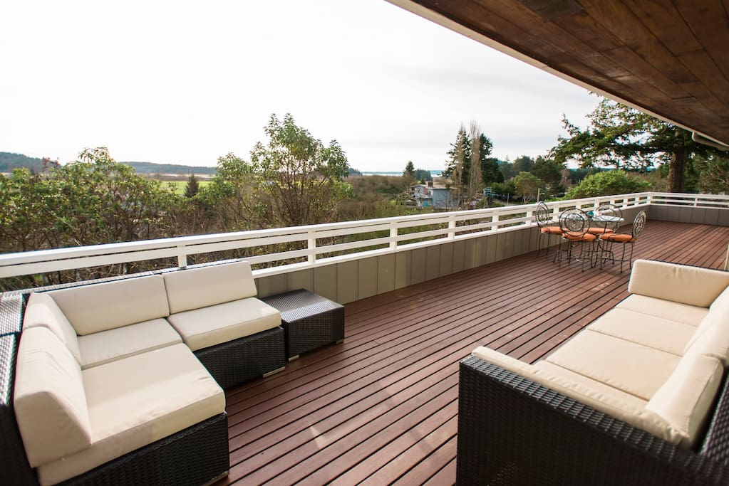 Soft comfortable furniture provide an outdoor living room on the East Deck