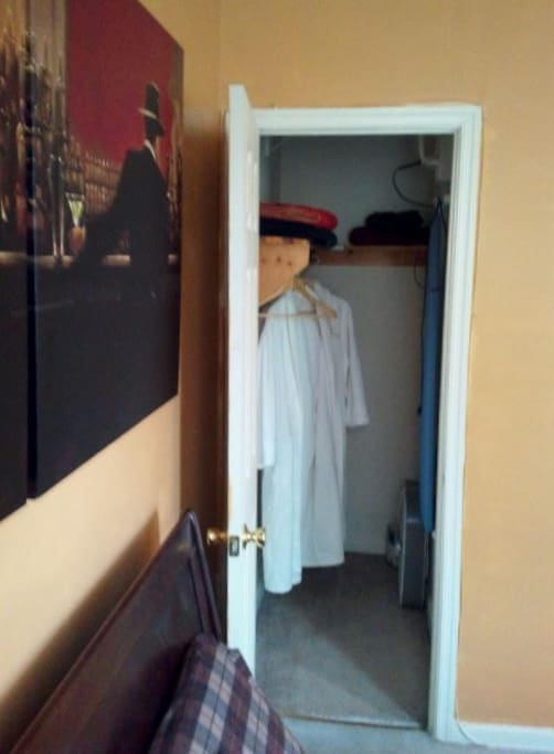 Walk-in closet w/ towels, robes, and iron w/ iron board if you are on a business trip!