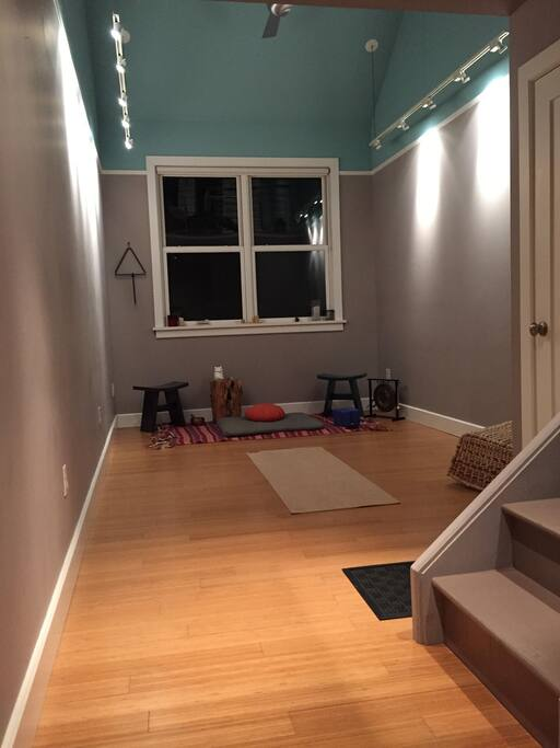 Yoga studio / meditation room / sunroom. Can also accommodate up to 2 air mattresses on request (one queen sized, one double), or a handful of cots for larger parties and more flexibility.