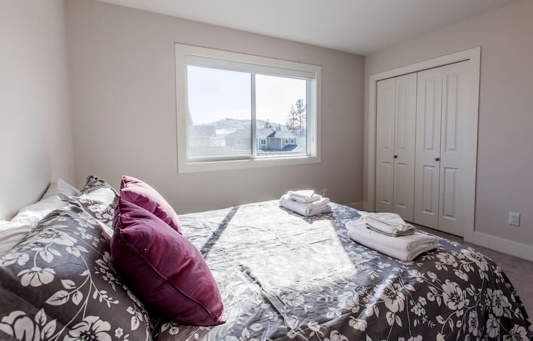 Bedroom # 2 also has a queen-size bed, a spacious closet and a beautiful view of the West Kelowna Valley and Okanagan Lake.