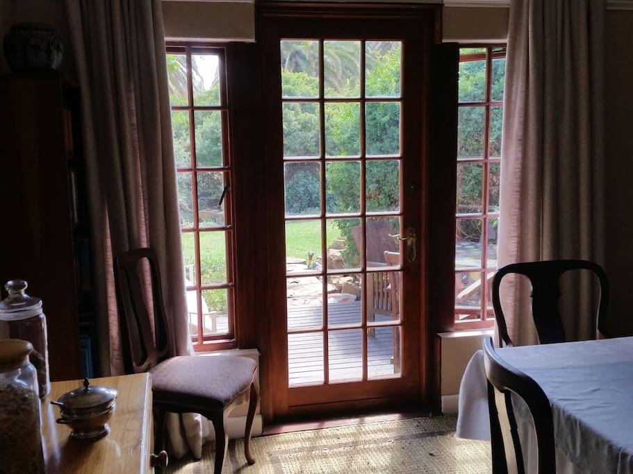 The guest dining area opens up to the front garden.
