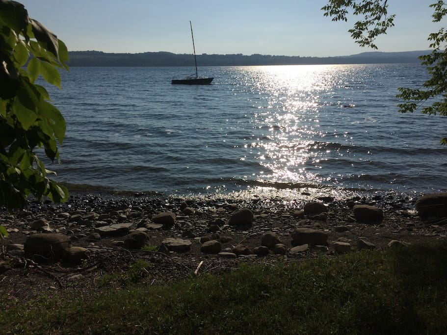 come enjoy the beautiful sunrises and sunsets over the lake. The lakefront sits 400 feet down a hill from the house.