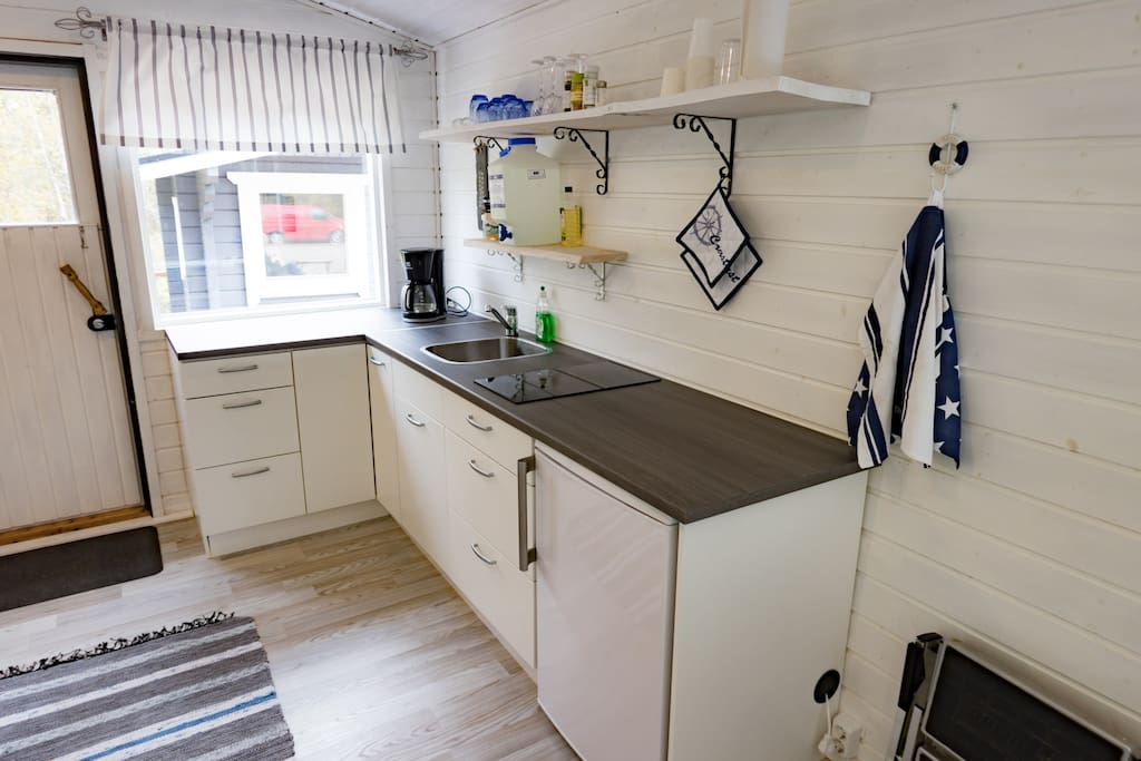 Kitchen include refrigerator and stove