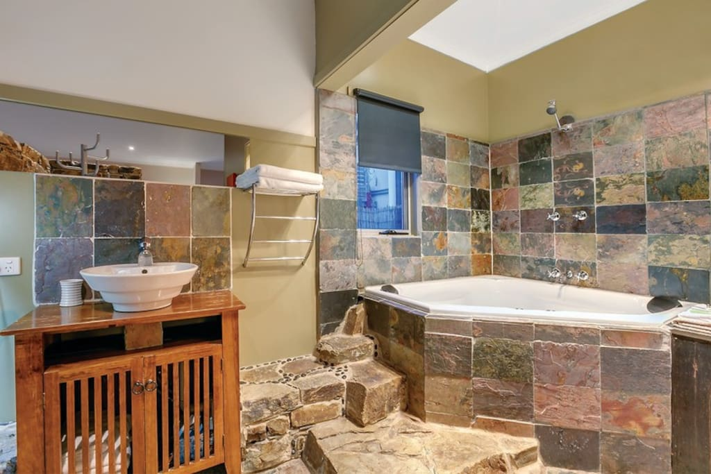 Gorgeous bathroom with luxury 2 person spa encased in Castlemaine slate