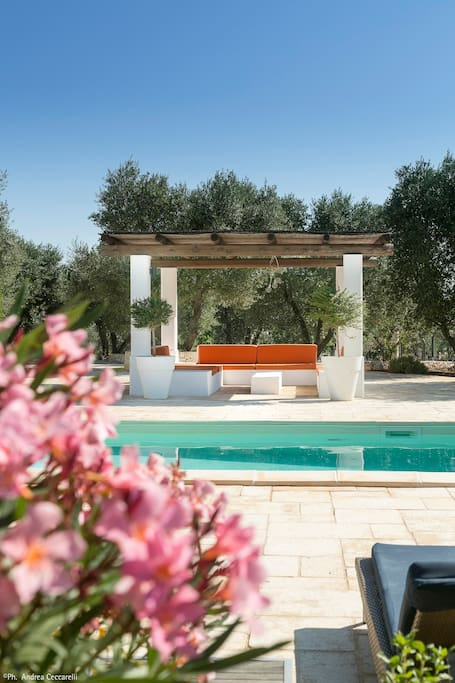 The bamboo shaded sofas at Trullo Fico