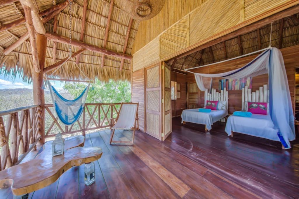 Your private cabin with 2 twins or king bed with doors opening out onto your balcony to swing in a hammock or relax in a deck chair