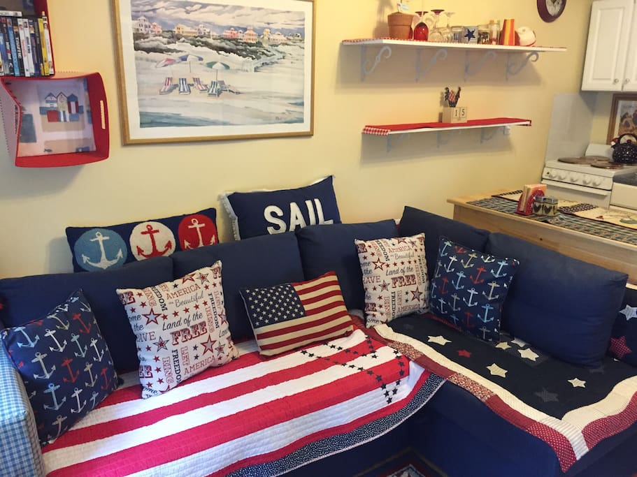 Nautical themed living room , couch pulls out to a full sized bed