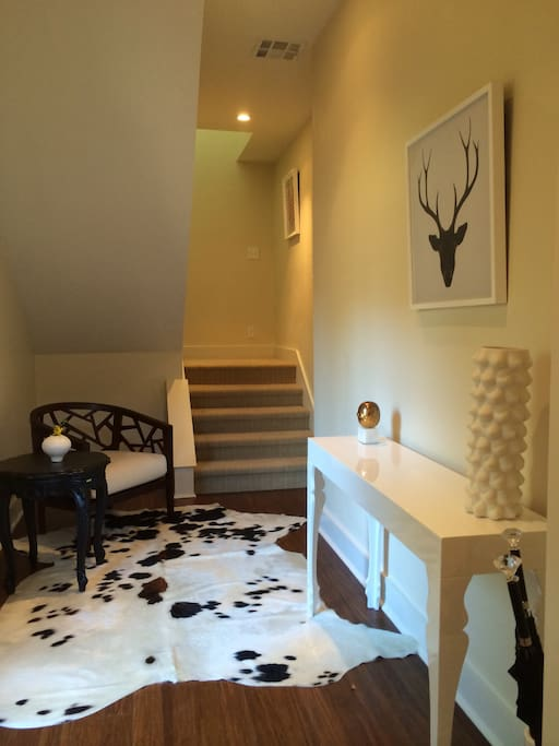Generous Foyer entrance with eclectic furnishings and art work.