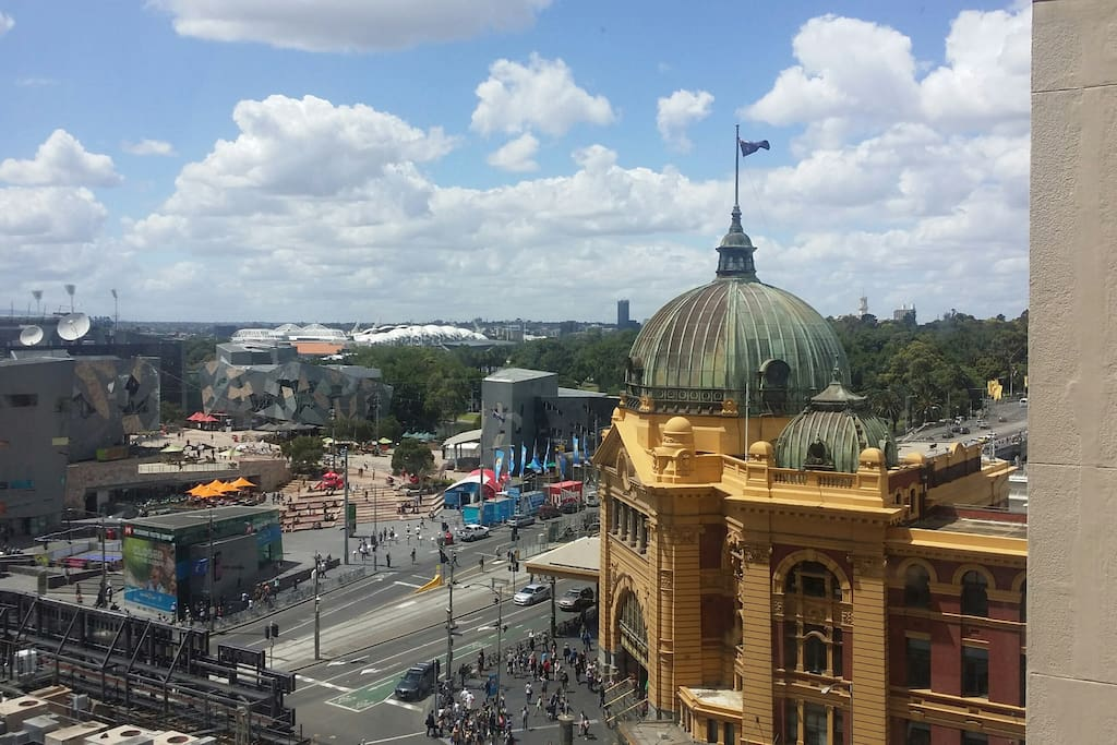 Day view from apartment window:  Federation Square, Flinders Street Station, and MCG, Tennis Centre and AAMI stadium in the distance