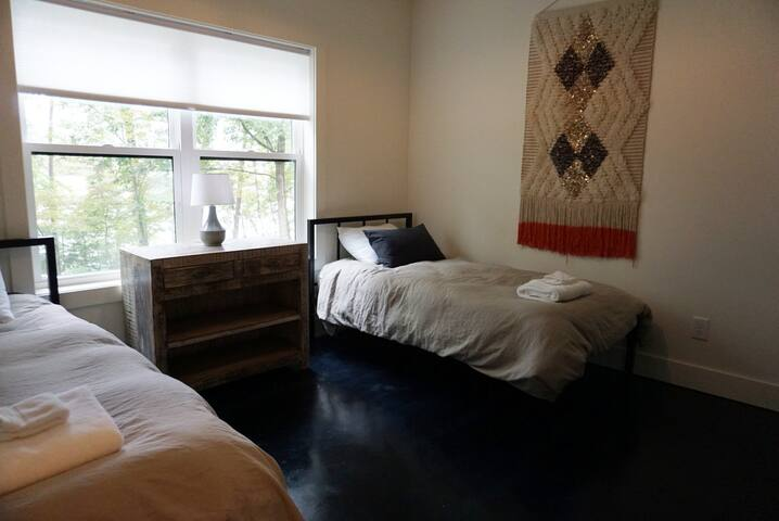 Terrace level twin bedroom with lake views