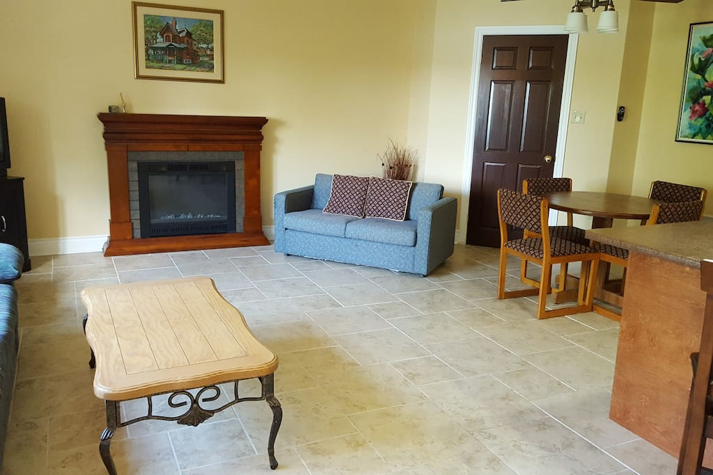 Looking into the family space you have stone flooring, kitchen, dinning and lounging area.