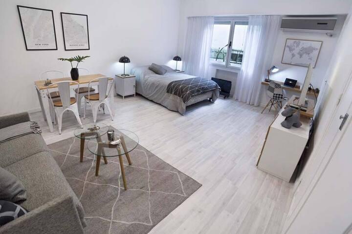 Modern Studio Grey - Posadas & Callao. Warmly decorated