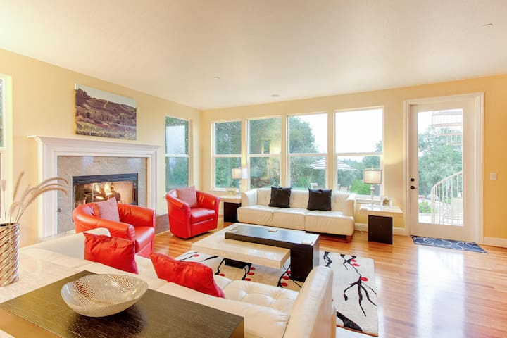 Seating surrounding the fireplace in the living room