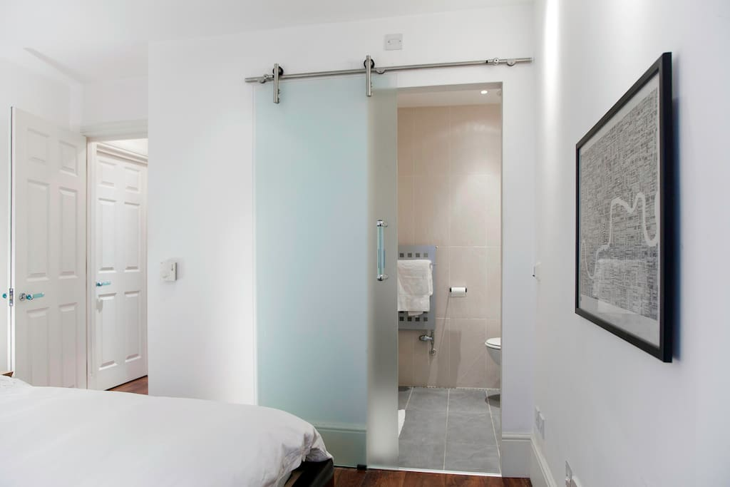 The bedroom has an en-suite shower and toilet