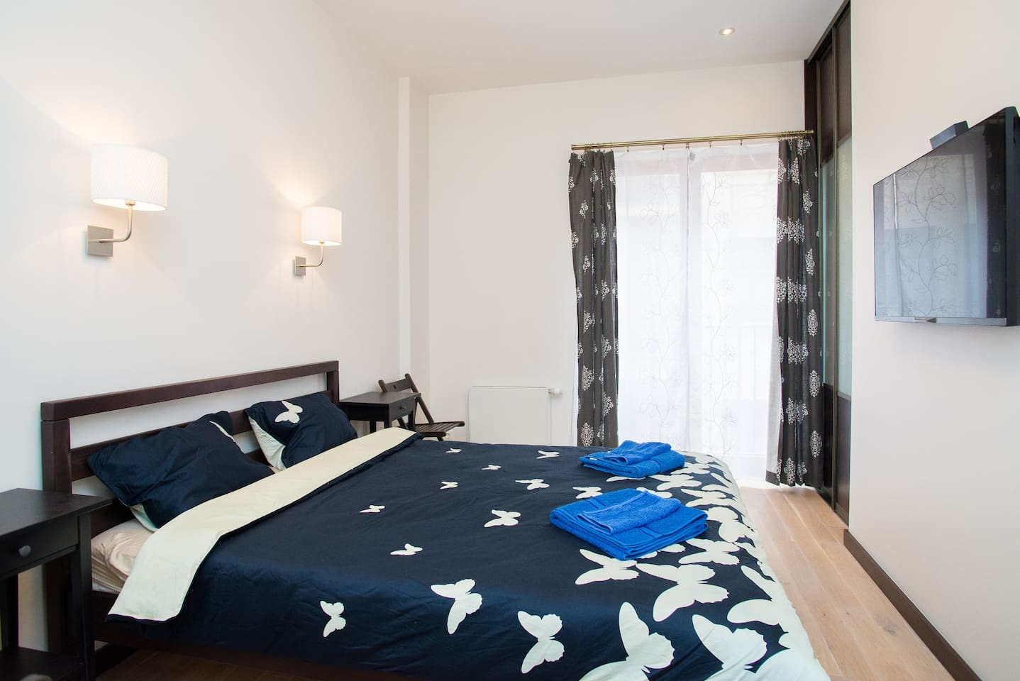 Two cozy and stylish bedrooms with King Size double beds, flat screen 42'' Smart TV with 100 international TV channels, work place and clothes storing place as well as air conditioner with remote control.