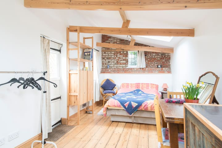 NB Airbnb photos use wide angle lenses! Kitchen, dining and sleeping area