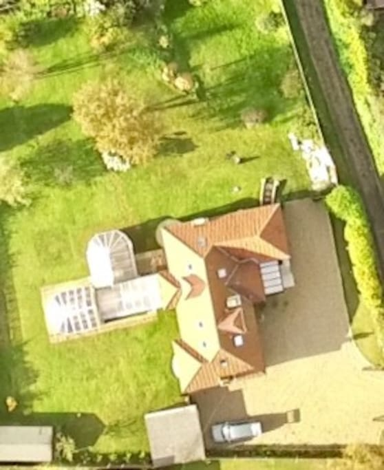 Aerial photo of half acre plot and house