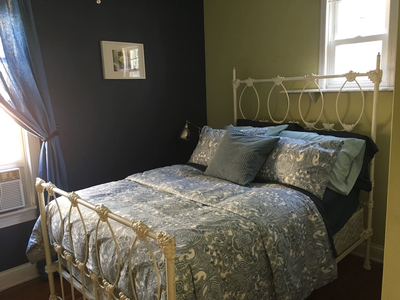 Antique bed has a double size spring mattress and assortment of pillows for comfort. Pillows include memory foam, feather and down alternative.