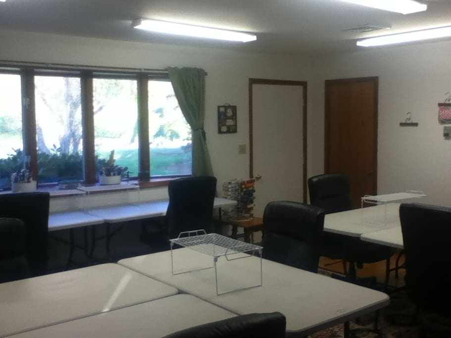 Specialty lights, accompanied with plenty of natural light creates the perfect work environment for crafting & quilting! Front entrance of the house leads directly into the main work room for easy loading/unloading.
